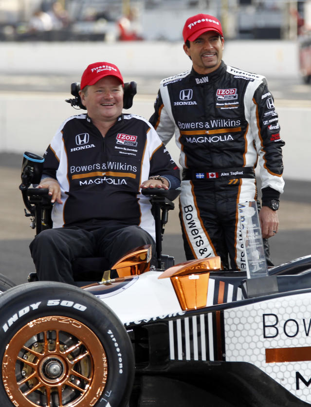 FILE - In this May 22, 2011 file photo, pole sitter Alex Tagliani, right, of Canada, poses with car owner Sam Schmidt on the start/finish line at the Indianapolis Motor Speedway in Indianapolis. Sam Schmidt was left quadriplegic from a racing accident and the team he later created has suffered a series of tragedies and setbacks. (AP Photo/Michael Conroy, File)