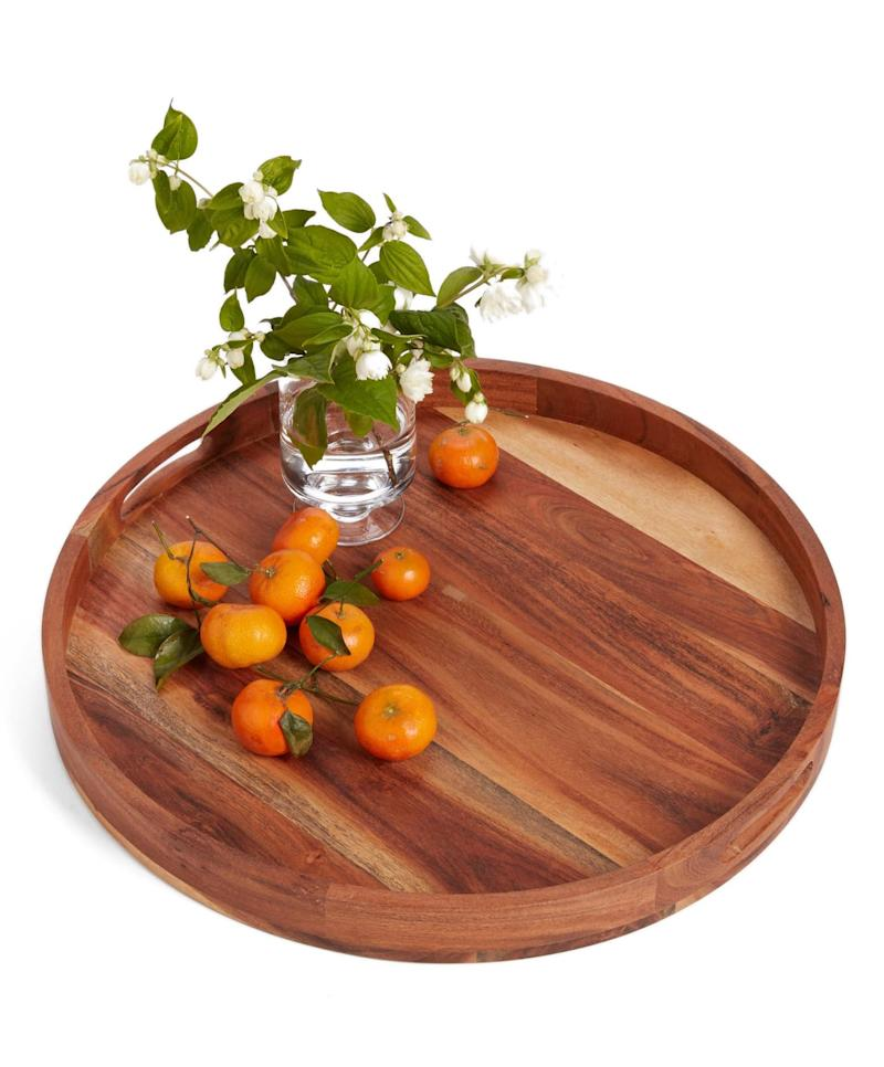 Nordstrom at Home Large Round Acacia Wood Serving Tray. Image via Nordstrom.