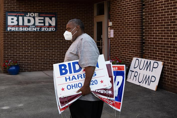 Tony Hickson holds signs in support of Joe Biden in Youngstown, Ohio on September 22, 2020. (Megan Jelinger/AFP via Getty Images)