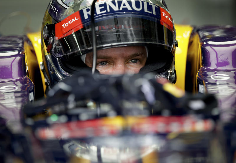 Red Bull driver Sebastian Vettel of Germany sits in his car in his garage during the third practice session for Sunday's Malaysian Formula One Grand Prix at Sepang, Malaysia, Saturday, March 23, 2013. (AP Photo/Andy Wong)