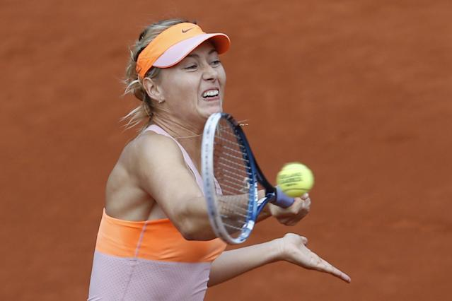 Russia's Maria Sharapova returns the ball during the third round match of the French Open tennis tournament against Argentina's Paula Ormaechea at the Roland Garros stadium, in Paris, France, Friday, May 30, 2014. Sharapova won in two sets 6-0, 6-0. (AP Photo/Darko Vojinovic)