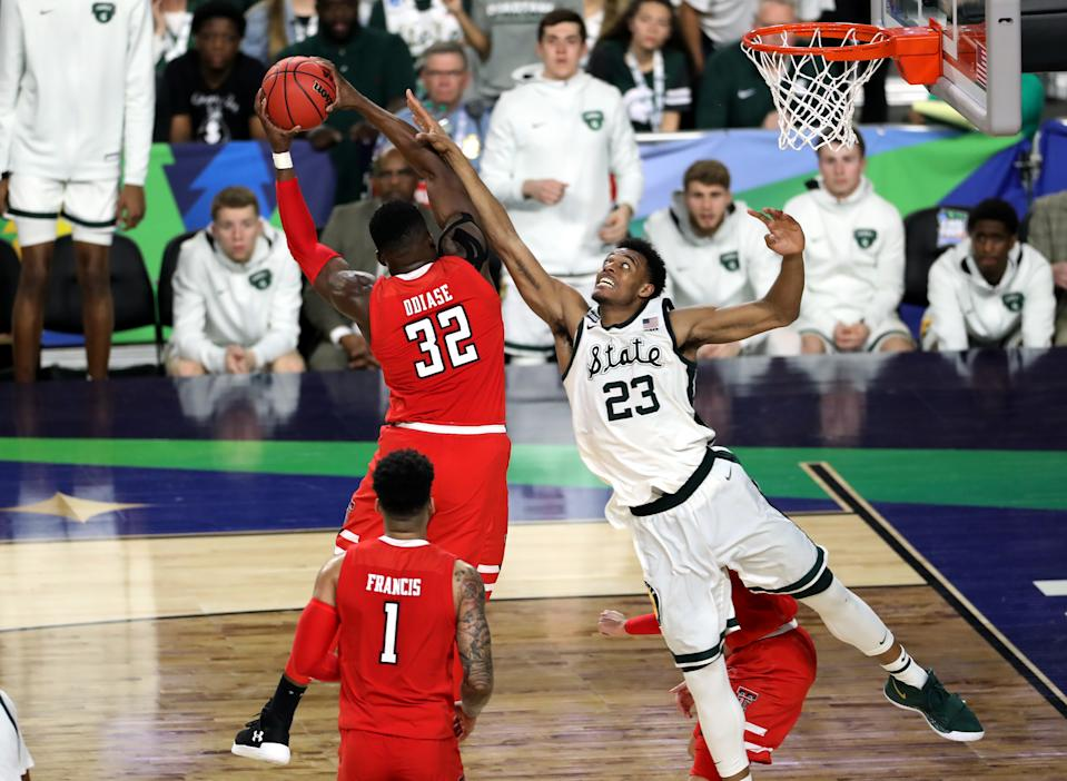 Norense Odiase #32 of the Texas Tech Red Raiders rebounds against Xavier Tillman #23 of the Michigan State Spartans during the second half of the semifinal game in the NCAA Men's Final Four at U.S. Bank Stadium on April 06, 2019 in Minneapolis, Minnesota. (Photo by Matt Marriott/NCAA Photos via Getty Images)
