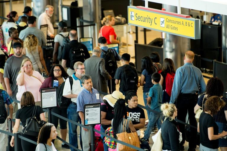 Travelers wait in line at Baltimore/Washington International Airport, where customs agents started Leon Haughton's long ordeal