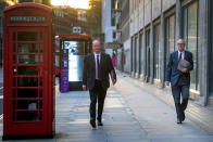 Britain's Chief medical officer Chris Whitty and chief scientific adviser Sir Patrick Vallance walk together on Victoria Street in Westminster, London, as England continues a four week national lockdown to curb the spread of coronavirus, Tuesday, Nov. 24, 2020. Prime Minister Boris Johnson will set out plans to the House of Commons for a strengthened three-tier system of coronavirus restrictions to replace the national lockdown in England and to pave the way for a limited relaxation at Christmas. (Victoria Jones/PA via AP)