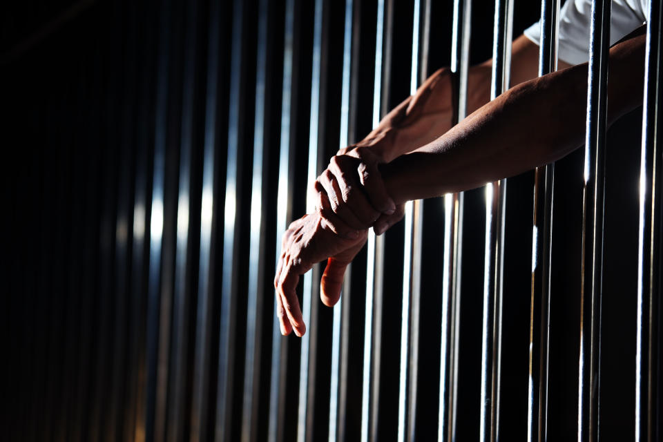 close up of hand in jail background.
