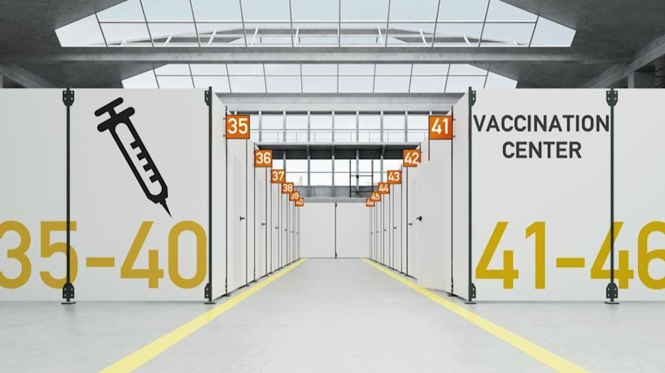 Temporary Corona vaccination center in warehouse with cabins.