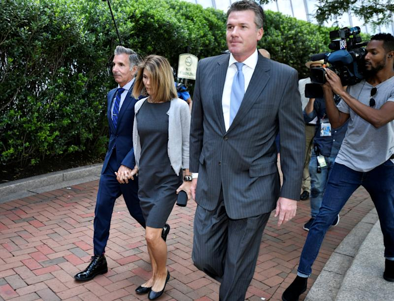 Actress Lori Loughlin and her husband, fashion designer Mossimo Giannulli, arrive at the federal courthouse for a hearing on charges in a nationwide college admissions cheating scheme in Boston, Massachusetts, U.S., August 27, 2019. REUTERS/Josh Reynolds