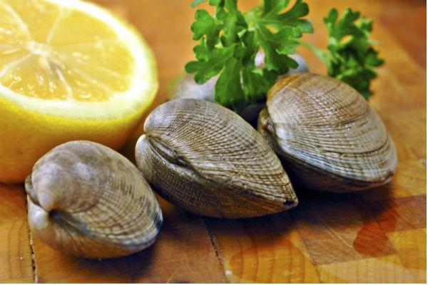 <p><strong>Ingredients</strong>:</p> <p>2 cups low-sodium chicken broth; <br />Pinch of saffron threads (optional); <br />8 scrubbed littleneck clams; <br />2 tablespoons olive oil; <br />2 ounces cured Spanish chorizo, sliced into 1/8-inch-thick rounds; <br />1/2 cup minced onion; <br />3 garlic cloves, thinly sliced; <br />1 teaspoon smoked paprika; <br />1 1/2 cups arborio rice; <br />Kosher salt and freshly ground black pepper; <br />1/3 cup dry white wine; <br />1 large roasted red pepper from a jar, drained, cut into 1/4-inch-wide strips; <br />1/2 cup frozen peas, thawed; </p>