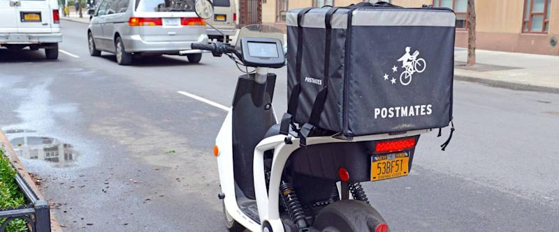 NEW YORK CIRCA MARCH 2018. Postmates delivery bicycle in Manhattan, a food service delivery company that works via mobile phone app which has tried to build a presence in the east coast.
