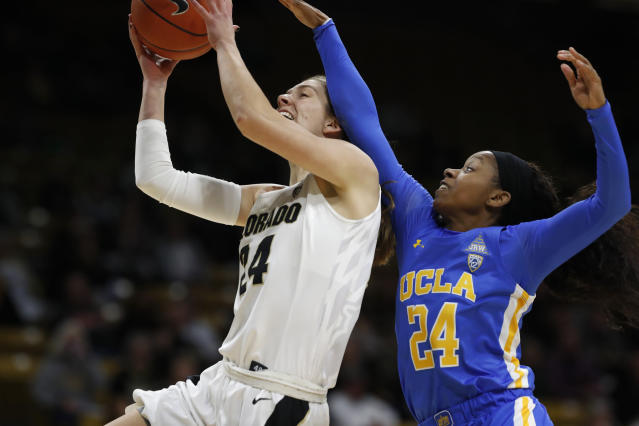 Colorado guard Aubrey Knight, left, is fouled as she goes up for a basket by UCLA guard Japreece Dean in the first half of an NCAA college basketball game Sunday, Jan. 12, 2020, in Boulder, Colo. (AP Photo/David Zalubowski)