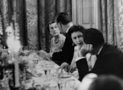 Queen Elizabeth II and American Vice-President Richard Nixon talk together at the table during the Thanksgiving Day dinner given by Mr and Mrs Nixon at the American Ambassador's residence, Winfield House, Regent's Park, London.