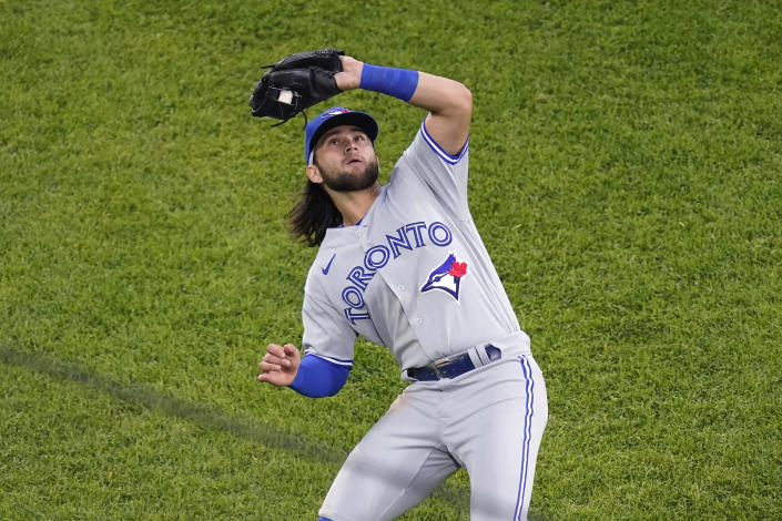 Toronto Blue Jays shortstop Bo Bichette catches a popup by Chicago White Sox's Yoan Moncada to end the third inning of a baseball game Wednesday, June 9, 2021, in Chicago. (AP Photo/Charles Rex Arbogast)