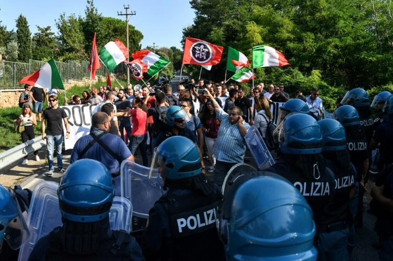 Tensions spilled over outside a church centre housing some 100 Eritrean migrants from the Diciotti rescue vessel at Rocca di Papa near Rome