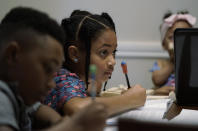 Jacoby Brown, 11, left, and sister, 9, practice math at their home in Austin, Texas, Tuesday, July 13, 2021. The U.S. Census Bureau reported in March that the rate of households homeschooling their children rose to 11% by September 2020, more than doubling from 5.4% just six months earlier. (AP Photo/Eric Gay)