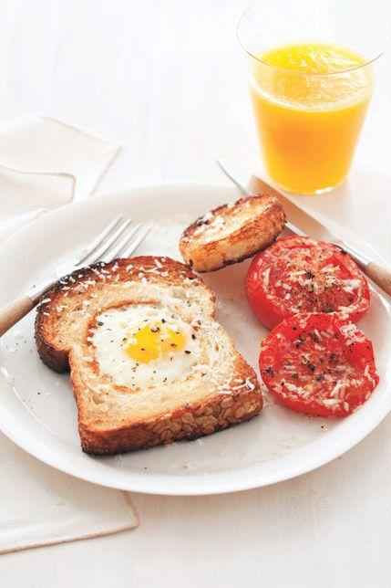 """<p>Dad used to make this cheery breakfast for you when you were a kid. Now it's time to return the favor.</p><p><strong><a rel=""""nofollow"""" href=""""https://www.womansday.com/food-recipes/food-drinks/recipes/a11647/egg-in-a-hole-broiled-tomatoes-recipe-122825/"""">Get the recipe.</a></strong></p>"""