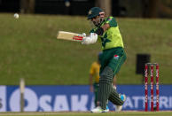 Pakistan's captain Babar Azam plays a shot during the fourth and final T20 cricket match between South Africa and Pakistan at Centurion Park in Pretoria, South Africa, Friday, April 16, 2021. (AP Photo/Themba Hadebe)