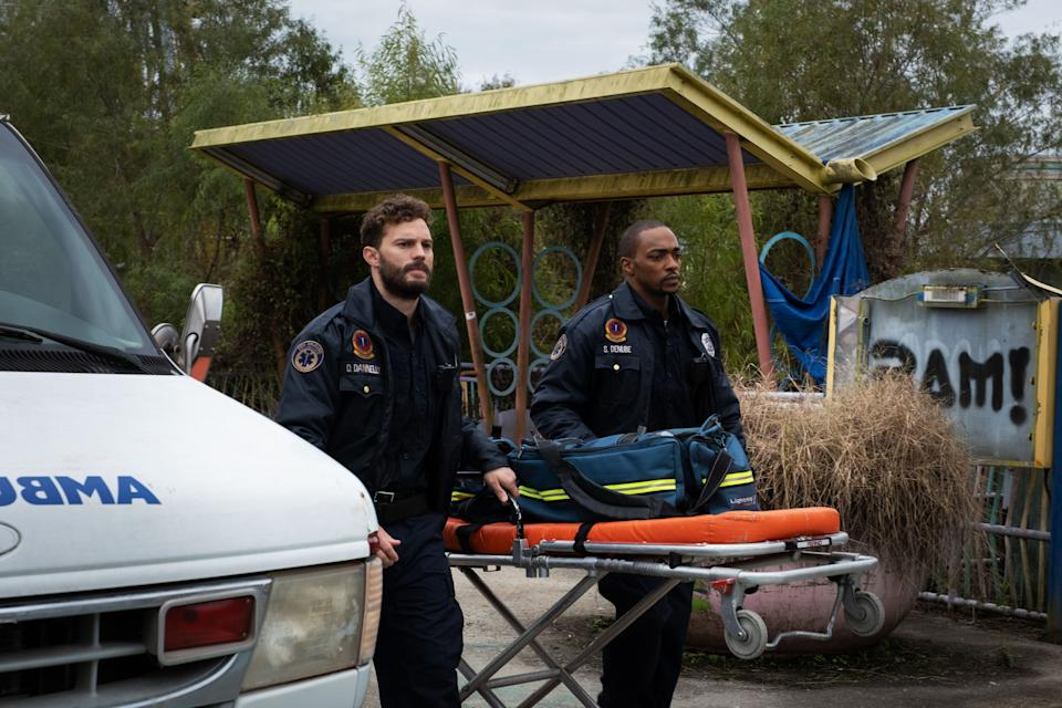 """Jamie Dornan (left) and Anthony Mackie play paramedics looking into new synthetic drug that allows people to time-travel in """"Synchronic."""""""