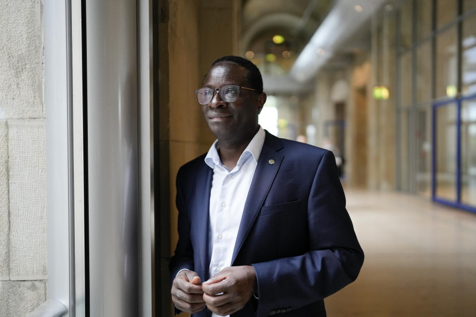 Social Democratic Party, SPD lawmaker Karamba Diaby, poses for a photo at the German parliament Bundestag building, the Reichstag Building, in Berlin, Tuesday, Sept. 28, 2021. Sunday's national election making Germany's lower house of parliament, or Bundestag, more diverse and inclusive than ever before. For the first time there are also two transgender women, at least three people of African descent and, after years of stagnation, the number of female lawmakers has gone up again as well. (AP Photo/Markus Schreiber)