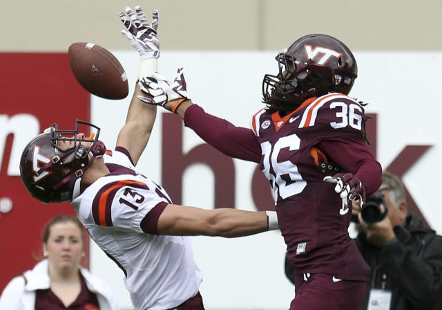 Adonis Alexander, knocking the ball away from receiver Caleb Farley during the Hokies' spring game in 2017, could be a supplemental draft selection on Wednesday. (AP)