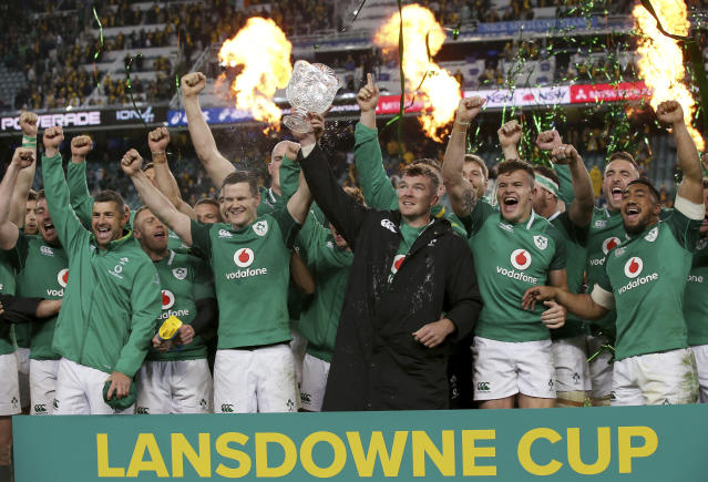 FILE - In this Saturday, June 23, 2018 file photo, Ireland's Peter O'Mahony, center, holds up the Lansdowne Cup as he celebrates with teammates following their win over Australia in their rugby union test match in Sydney. After his No. 1-ranked All Blacks lost to the Irish last November in Dublin, coach Steve Hansen hailed Ireland as the best team in the world. The good vibes lasted for 76 days, until England showed up at Lansdowne Road in February and brought the Irish plummeting to earth in a crushing defeat to open the Six Nations. Wales smashed them again to clinch the title, and doubts swirled about Ireland's ability to contend for the World Cup. (AP Photo/Rick Rycroft, file)