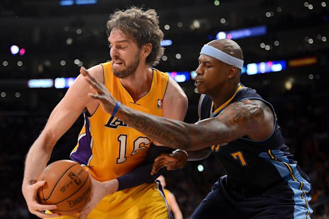 LOS ANGELES, CA - MAY 12: Pau Gasol #16 of the Los Angeles Lakers attempts to move the ball from Al Harrington #7 of the Denver Nuggets in the first half in Game Seven of the Western Conference Quarterfinals in the 2012 NBA Playoffs on May 12, 2012 at Staples Center in Los Angeles, California. NOTE TO USER: User expressly acknowledges and agrees that, by downloading and or using this photograph, User is consenting to the terms and conditions of the Getty Images License Agreement. (Photo by Harry How/Getty Images)