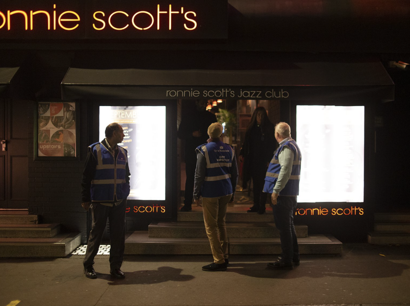 A photo of Ronnie Scott's Jazz Club staff reassuring London's city inspectors they were abiding by new coronavirus rules.