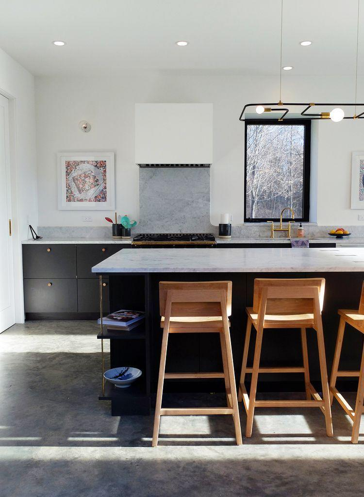 <p>Concrete floors brings an understated edge to this kitchen designed by Studio DB. While classic hardwood panels or fun colorful tiles would also work well in this family home, the sleek grittiness of concrete is a welcome surprise. </p>