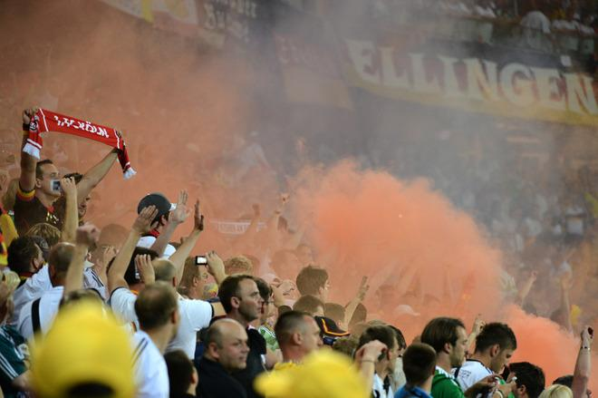 German supporters use smoke grenades to celebrate at the end of the Euro 2012 football championships match Denmark vs. Germany, on June 17, 2012 at the Arena Lviv in Lviv.  Germany won 2-1. Denmark is out of the competition. AFP PHOTO / DAMIEN MEYERDAMIEN MEYER/AFP/GettyImages