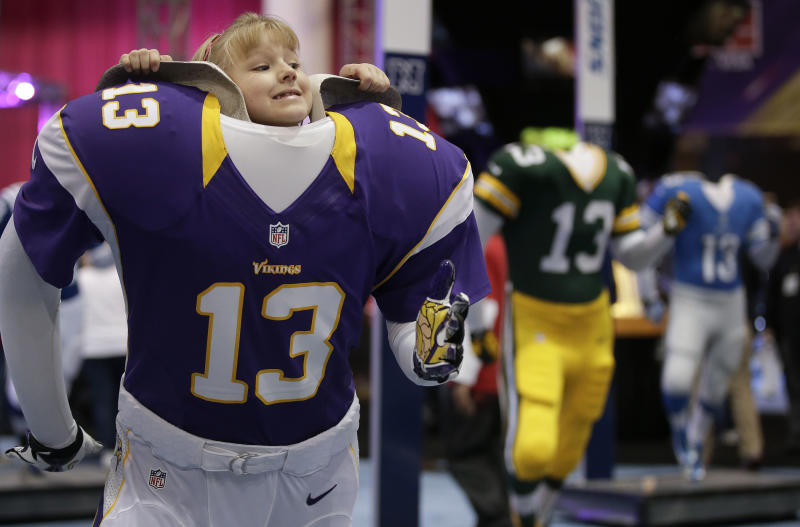 FILE - In this Feb. 1, 2013 file photo, Maddie Cooney, 6, just gets her chin high enough for a photo inside a Minnesota Vikings mannequin at the NFL Experience in New Orleans. Feb. 2, 2014, is a day that will be remembered forever in not only the NFL, but in New York and New Jersey, as the Super Bowl will be played outdoors in a northern market for the first time ever. Indeed, NFL Commissioner Roger Goodell has overcome quite a few challenges in his tenure, but this one may be the toughest. (AP Photo/Julie Jacobson, File)
