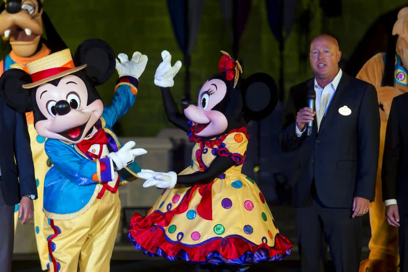 Bob Chapek, chairman of Walt Disney Parks and Resorts, speaks next to Mickey Mouse and Minnie Mouse during the 10th anniversary ceremony of Hong Kong Disneyland in Hong Kong