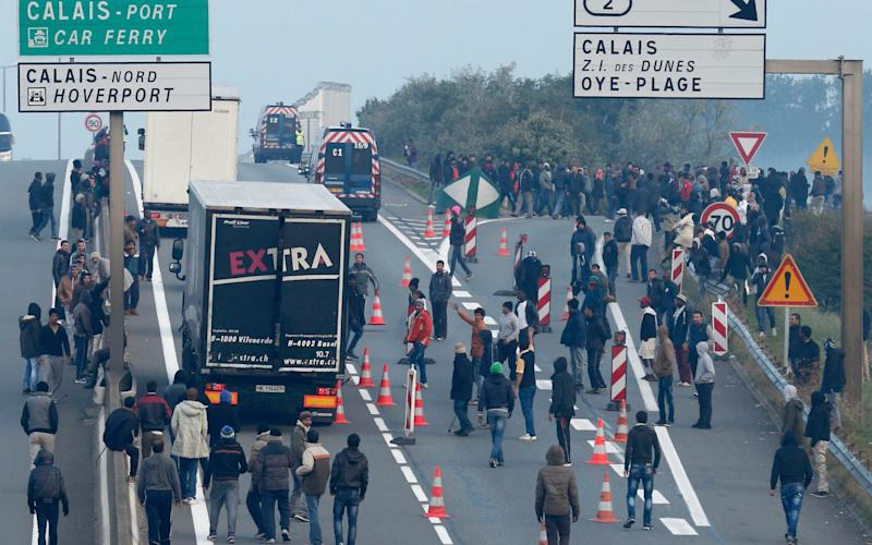 migrants and lorries - Credit: Reuters
