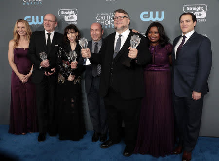 """23rd Critics' Choice Awards – Photo Room – Santa Monica, California, U.S., 11/01/2018 – Guillermo del Toro and cast pose backstage with their Best Picture and Best Director awards for """"The Shape of Water"""". REUTERS/Monica Almeida/Files"""