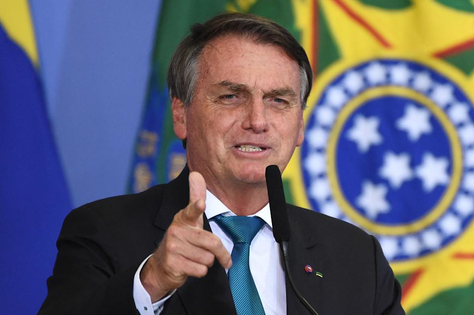 Brazilian President Jair Bolsonaro gestures during a ceremony for the Olympic and Paralympic athletes who participated in the Tokio 2020 Olympic Games, at Planalto Palace in Brasilia, on October 6, 2021. (Photo by EVARISTO SA / AFP) (Photo by EVARISTO SA/AFP via Getty Images)