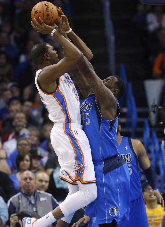 Oklahoma City Thunder forward Kevin Durant (35) shoots as Dallas Mavericks center DeJuan Blair (45) defends in the first quarter of an NBA basketball game in Oklahoma City, Sunday, March 16, 2014. (AP Photo/Sue Ogrocki)