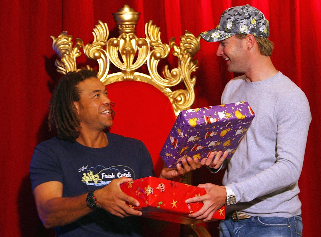 MELBOURNE, AUSTRALIA - DECEMBER 25:  Andrew Symonds and Michael Clarke exchange gifts at a photo session after the Australian nets session at the Melbourne Cricket Ground on December 25, 2006 in Melbourne, Australia.  (Photo by Aaron Francis/Getty Images)