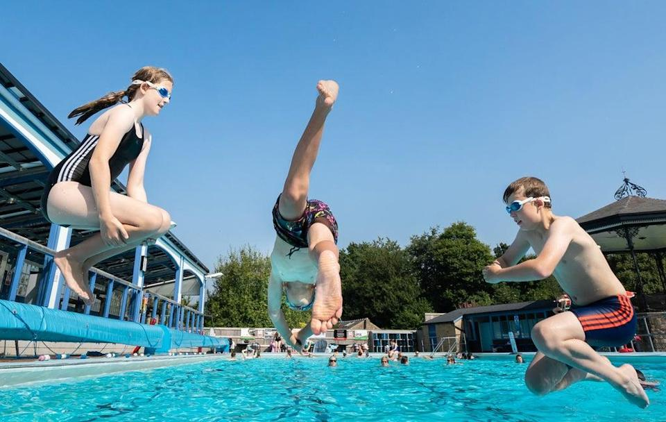 People enjoy the hot weather at Hathersage swimming pool in the Hope Valley, Peak District (Danny Lawson/PA) (PA Wire)