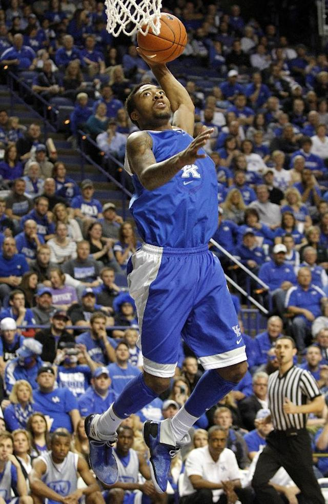 Blue team's James Young dunks during Kentucky's NCAA college basketball scrimmage, Tuesday, Oct. 29, 2013, in Lexington, Ky. The Blue team won 99-71. (AP Photo/James Crisp)