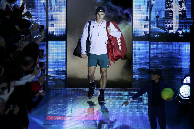 Roger Federer of Switzerland arrives for his ATP World Tour Finals semifinal tennis match against David Goffin of Belgium at the O2 Arena in London, Saturday Nov. 18, 2017. (AP Photo/Tim Ireland)