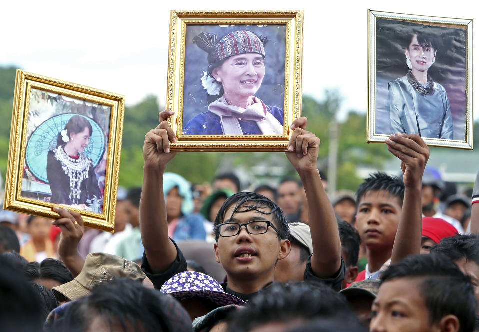 In this Oct. 22, 2017, file photo, supporters raise portraits of Myanmar's leeader Aung San Suu Kyi during a public rally to show their support for her in Naypyitaw, Myanmar. After Myanmar's military staged a coup Monday, Feb. 1, 2021, Aung San Suu Kyi finds herself back under house arrest. But this time, her standoff with the generals comes after she has sorely disappointed many once-staunch supporters in the international community. (AP photo/Aung Shine Oo, file)
