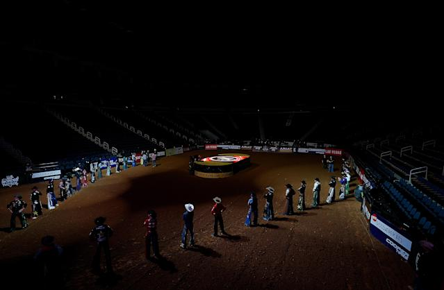 Riders prepare to compete in an empty arena. (Photo by Kevin C. Cox/Getty Images)