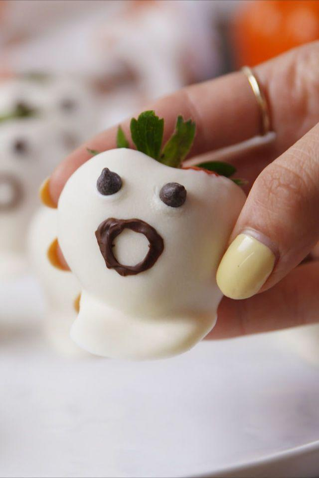 """<p>This recipe is as easy as dipping strawberries in white chocolate and drawing little faces on them with milk chocolate. </p><p><em><strong>Get the recipe at <a href=""""https://www.delish.com/cooking/recipe-ideas/recipes/a55595/strawberry-ghosts-recipe/"""" rel=""""nofollow noopener"""" target=""""_blank"""" data-ylk=""""slk:Delish"""" class=""""link rapid-noclick-resp"""">Delish</a>.</strong></em></p>"""