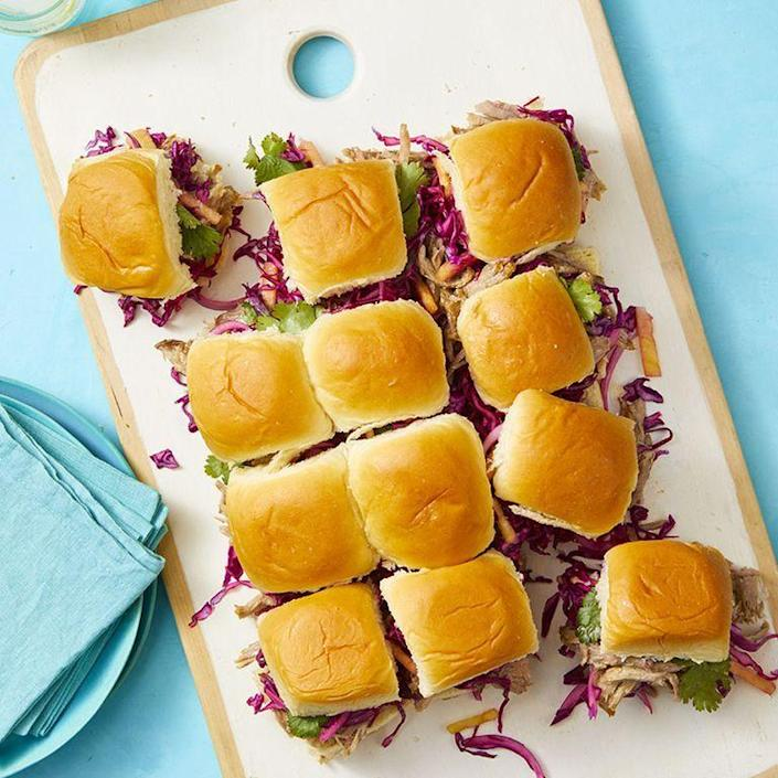 """<p>Piled high with Instant Pot pulled pork and pineapple cabbage slaw, your guests will not be able to get enough of these mini sandwiches. </p><p><em><a href=""""https://www.womansday.com/food-recipes/food-drinks/a27483675/hawaiian-pork-pull-apart-rolls-recipe/"""" rel=""""nofollow noopener"""" target=""""_blank"""" data-ylk=""""slk:Get the Hawaiian Pork Pull-Apart Rolls recipe."""" class=""""link rapid-noclick-resp"""">Get the Hawaiian Pork Pull-Apart Rolls recipe.</a></em></p>"""