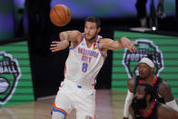 Oklahoma City Thunder's Danilo Gallinari (8) passes the ball as Houston Rockets' James Harden, bottom right, and Robert Covington, right rear, look on during the second half of an NBA first-round playoff basketball game in Lake Buena Vista, Fla., Wednesday, Sept. 2, 2020. (AP Photo/Mark J. Terrill)