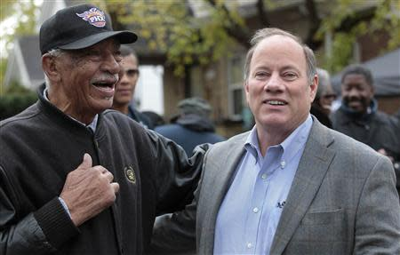 Detroit mayoral candidate Mike Duggan (R) chats with Detroit resident David Miller as he makes a campaign stop in the neighborhood he lived in as a child in Detroit, Michigan November 2, 2013. REUTERS/Rebecca Cook