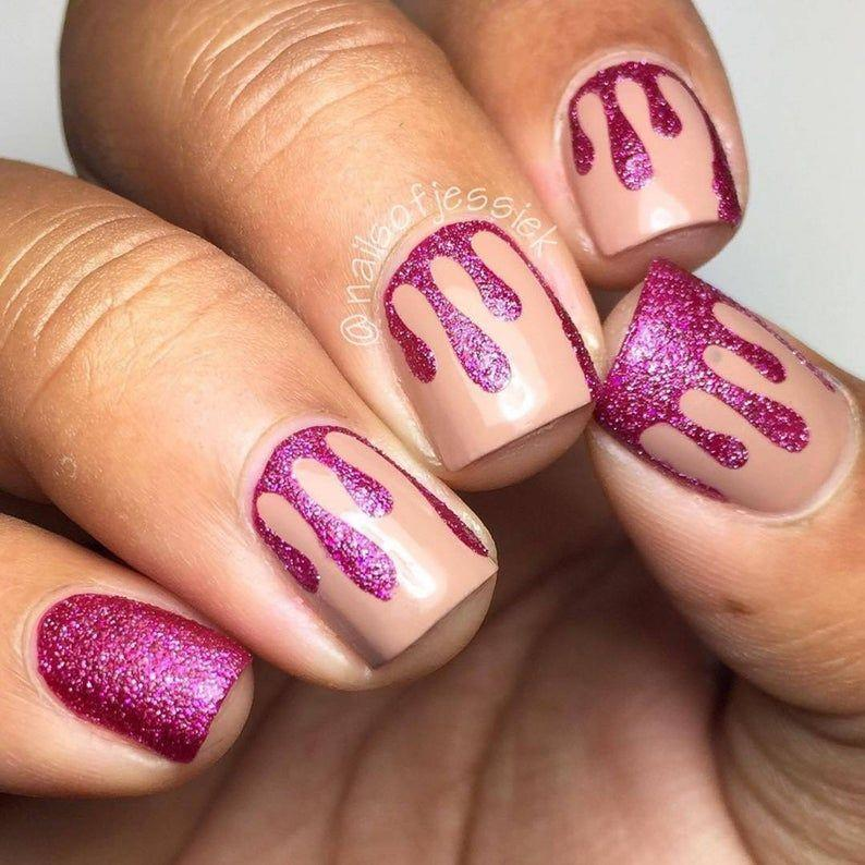 """<p><strong>WhatsUpNails</strong></p><p>etsy.com</p><p><strong>$3.75</strong></p><p><a href=""""https://go.redirectingat.com?id=74968X1596630&url=https%3A%2F%2Fwww.etsy.com%2Flisting%2F250854693%2Fdripping-tape-for-nail-art-drip-stickers&sref=https%3A%2F%2Fwww.oprahdaily.com%2Fbeauty%2Fskin-makeup%2Fg33239588%2Fhalloween-nail-ideas%2F"""" rel=""""nofollow noopener"""" target=""""_blank"""" data-ylk=""""slk:Shop Now"""" class=""""link rapid-noclick-resp"""">Shop Now</a></p><p>Looking for a drippy nail design that's not so bloody? This tape makes it easy to create a fun multicolor one with contrasting combinations that pop. </p>"""