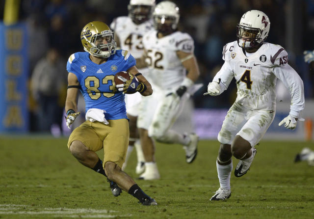UCLA wide receiver Grayson Mazzone, left, injures his left knee as he runs the ball while Arizona State safety Alden Darby defends during the second half an NCAA college football game, Saturday, Nov. 23, 2013, in Pasadena,Calif. Mazzone needed to be helped off the field. (AP Photo/Mark J. Terrill)