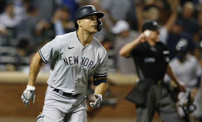 New York Yankees' Giancarlo Stanton rounds the bases after hitting a home run during the seventh inning of a baseball game against the New York Mets, Sunday, Sept. 12, 2021, in New York. (AP Photo/Noah K. Murray)