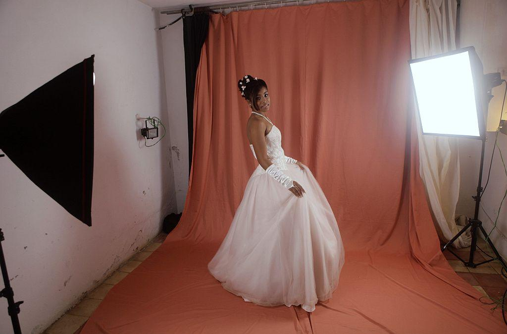 <p>Carmen Gonzalez poses during a photo session for her quinceanera (coming-out for 15-year-olds) celebration, in Havana, January 14, 2013. As nearly all Cuban girls dream of having a quinceanera, the industry that moves around that dream is large, with clients ranging from wealthy Cuban-Americans who travel back to the island to sponsor lavish parties, to regular Cubans who save a few hundred dollars over several years from their monthly $18 state wage. Picture taken January 14, 2013. REUTERS/Desmond Boylan (CUBA - Tags: SOCIETY)</p>