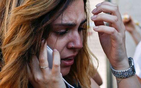<span>A woman cries as she phones after a van ploughed into the crowd, killing one person and injuring several others on the Rambla in Barcelona</span> <span>Credit: AFP/Getty Images </span>
