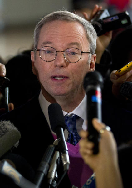 Google executive chairman Eric Schmidt briefs journalists after he arrived at Beijing Capital International Airport from Pyongyang, in Beijing Thursday, Jan. 10, 2013. Schmidt is urging North Korea to shed its self-imposed isolation and allow its citizens to use the Internet or risk being left behind economically. (AP Photo/Alexander F. Yuan)